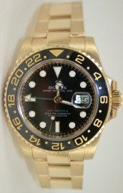Rolex GMT Master II 116718 Ceramic Bezel Black Dial in 18K Yellow Gold