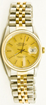 Rolex Men's Datejust Model 16013 Stainless Steel & Gold Jubilee Band With A Factory Champagne Stick Dial & A Fluted Bezel