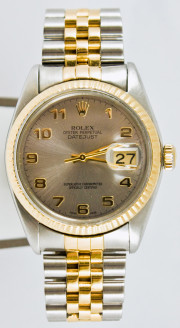 Rolex Men's Datejust Model 16013 Stainless Steel & Yellow Gold With A & Factory Silver Arabic Dial And A Fluted Bezel