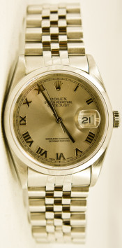 Rolex Men's 36mm Datejust Model 16030 Stainless Steel Jubilee Band With A Factory Silver Roman Dial & Smooth Bezel