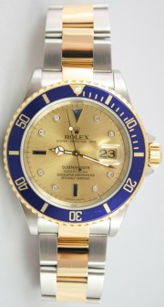 Rolex Submariner 16613 Stainless Steel and 18K Gold Blue Insert with Factory Original Champagne Serti Diamond and Sapphire Dial - 2005