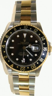 Rolex GMT Master II 16713 Steel and 18K Yellow Gold Oyster Band Model Black Face and Bezel