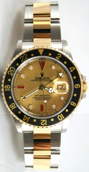 Rolex GMT Master II Steel and Gold Model 16713 Custom Champagne Diamond & Ruby Face