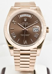 Unused Rolex Men's 40mm President Model 228235 18k Rose Gold Presidential New Style Heavy Band Chocolate Dial With Roman Markers & A Fluted Bezel
