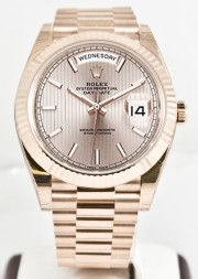 Unused Rolex Men's 40mm President Model 228235 18k Rose Gold Presidential New Style Heavy Band Sundust Motif Dial With Index Markers & A Fluted Bezel