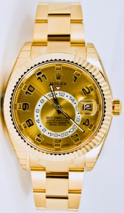 Rolex 42mm Sky Dweller 18K Yellow Gold Watch Model 326938 Oyster Band Champagne Face & Rotatable Bezel - UNUSED