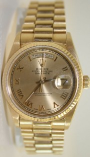 Rolex Day-Date President 18K Yellow Gold In Mint Condition with Champagne Raised Roman Dial and 18K Gold Fluted Bezel